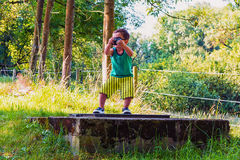 Little boy with photo camera Royalty Free Stock Photos