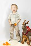 Little boy photographed in studio Christmas with gifts Stock Photography