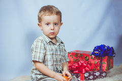 Little boy photographed in studio Christmas with gifts Royalty Free Stock Photo