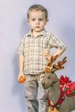 Little boy photographed in studio Christmas with gifts Royalty Free Stock Image