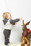 Little boy photographed in studio Christmas with gifts Royalty Free Stock Photography