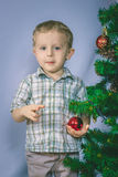 Little boy photographed in studio Christmas with gifts Royalty Free Stock Images