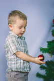 Little boy photographed in studio Christmas with gifts Stock Photo