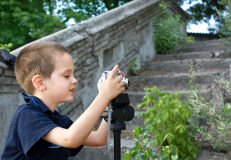 Little boy photographer Royalty Free Stock Image