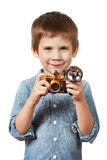 Little boy photographer shooting with retro camera and flash Royalty Free Stock Photo