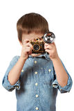 Little boy photographer shooting with retro camera and flash Royalty Free Stock Images