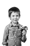 Little boy photographer shooting with retro camera and flash Stock Images