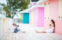 Little boy photographing his family Stock Photos
