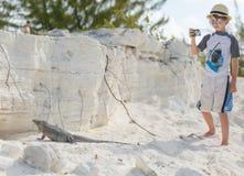 Little boy photographing iguana Royalty Free Stock Photography