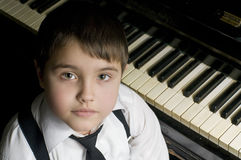 Little boy and piano. Royalty Free Stock Photography