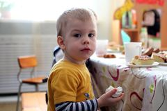 Little boy picked up a sweet treat turned looks stock photo