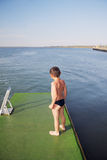 Little boy on pier Stock Photo