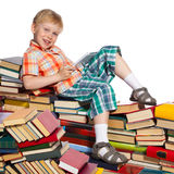 Little boy on a pile of books Stock Image