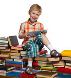 Little boy on a pile of books Royalty Free Stock Photo