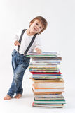 Little boy with a pile of books Stock Photo