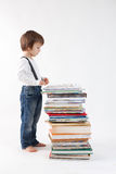 Little boy with a pile of books Royalty Free Stock Photo