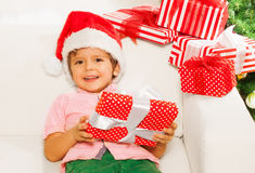 Little boy with pile of Christmas presents Royalty Free Stock Photos