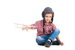 Little boy with pilot hat and toy airplane Royalty Free Stock Image