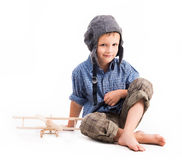 Little boy with pilot hat and toy airplane Royalty Free Stock Photo