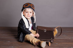 Little boy pilot plays in airplanes Royalty Free Stock Photography