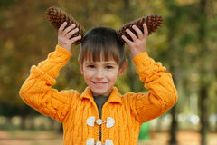 Little boy with pinecones in park Royalty Free Stock Photography