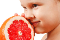 Little boy with a pink grapefruit Stock Photography