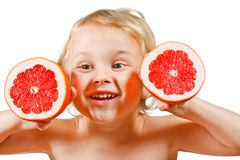 Little boy with a pink grapefruit Royalty Free Stock Photography