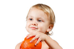 Little boy with a pink grapefruit Royalty Free Stock Image