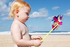 Little boy with pinwheel Stock Images