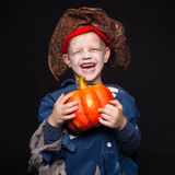 Little boy in a pirate costume for Halloween on a black background. Royalty Free Stock Photos