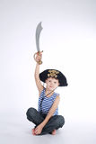 Little boy in pirate costume on white Stock Photos
