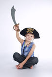 Little boy in pirate costume on white. Background stock image