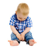 Little boy in a plaid shirt and jeans Stock Photos