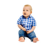 Little boy in a plaid shirt and jeans Royalty Free Stock Image