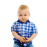 Little boy in a plaid shirt and jeans Stock Photography