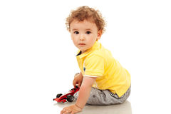 Little boy plaing with a toy car Royalty Free Stock Photos