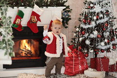 Little boy plaing with toys near the fire place Royalty Free Stock Photography
