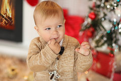 Little boy plaing with toys near the fire place Stock Images