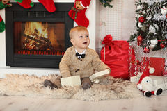 Little boy plaing with toys near the fire place Stock Photos