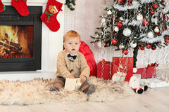 Little boy plaing with toys near the fire place Royalty Free Stock Photos