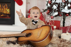 Little boy plaing with toys near the fire place Stock Photography