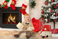 Little boy plaing with toys near the fire place Stock Image