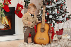 Little boy plaing with toys near the fire place Stock Photo