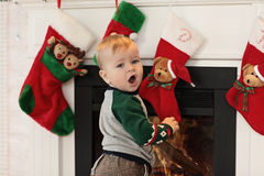 Little boy plaing with toys near the fire place Royalty Free Stock Images