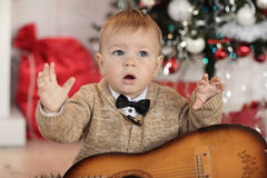 Little boy plaing with toys near the fire place Royalty Free Stock Photo