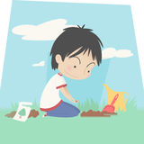 Little boy planting seeds Stock Photo