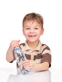 Little boy with plastic bottle of water Royalty Free Stock Photo