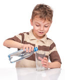 Little boy with plastic bottle of water Royalty Free Stock Image