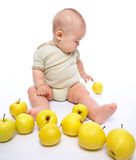 Little boy play with apples Royalty Free Stock Photos