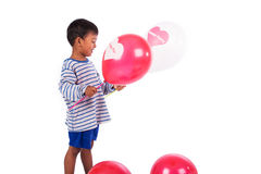 Little boy play balloon Stock Photos
